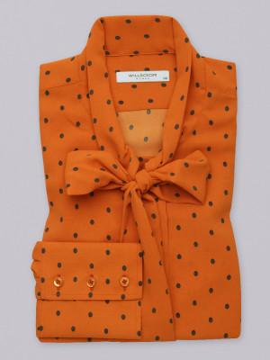 Pomarańczowa bluzka typu long size w groszki